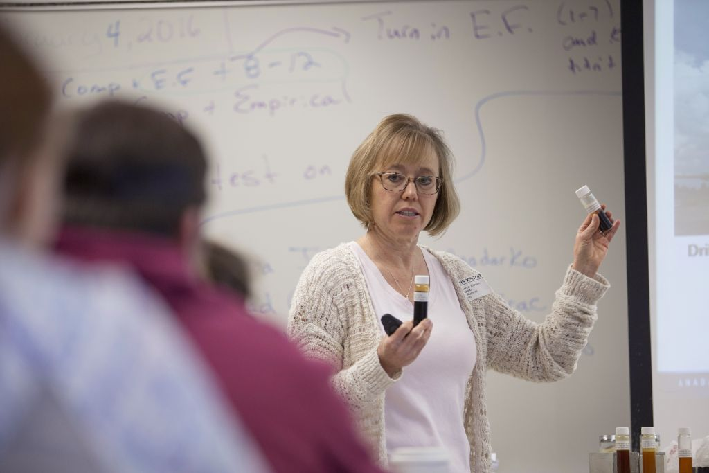 Rebecca Johnson, a representative from Anadarko Petroleum Corp, speaks to students during a chemistry class at Windsor High School in Windsor, Colorado, on Thursday, Feb. 4, 2016. Facing ballot initiatives restricting hydraulic fracturing (fracking), Anadarko Petroleum Corp deployed 160 landmen, geologists and engineers to Rotary clubs, high schools and mothers groups. They demonstrate how drilling works and try to convince people that the technique and the accompanying chemicals and geological effects dont harm the environment or public health. (Photo by Matthew Staver/Bloomberg via Getty Images