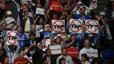 Protesters state their position on the Trans-Pacific Partnership, during the first day of the Democratic National Convention in Philadelphia on Monday, July 25, 2016. (Toni L. Sandys/The Washington Post via Getty Images)