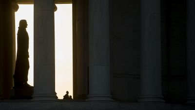 The sun sets behind the Jefferson Memorial in Washington. (Photo By Bill Clark/CQ Roll Call)