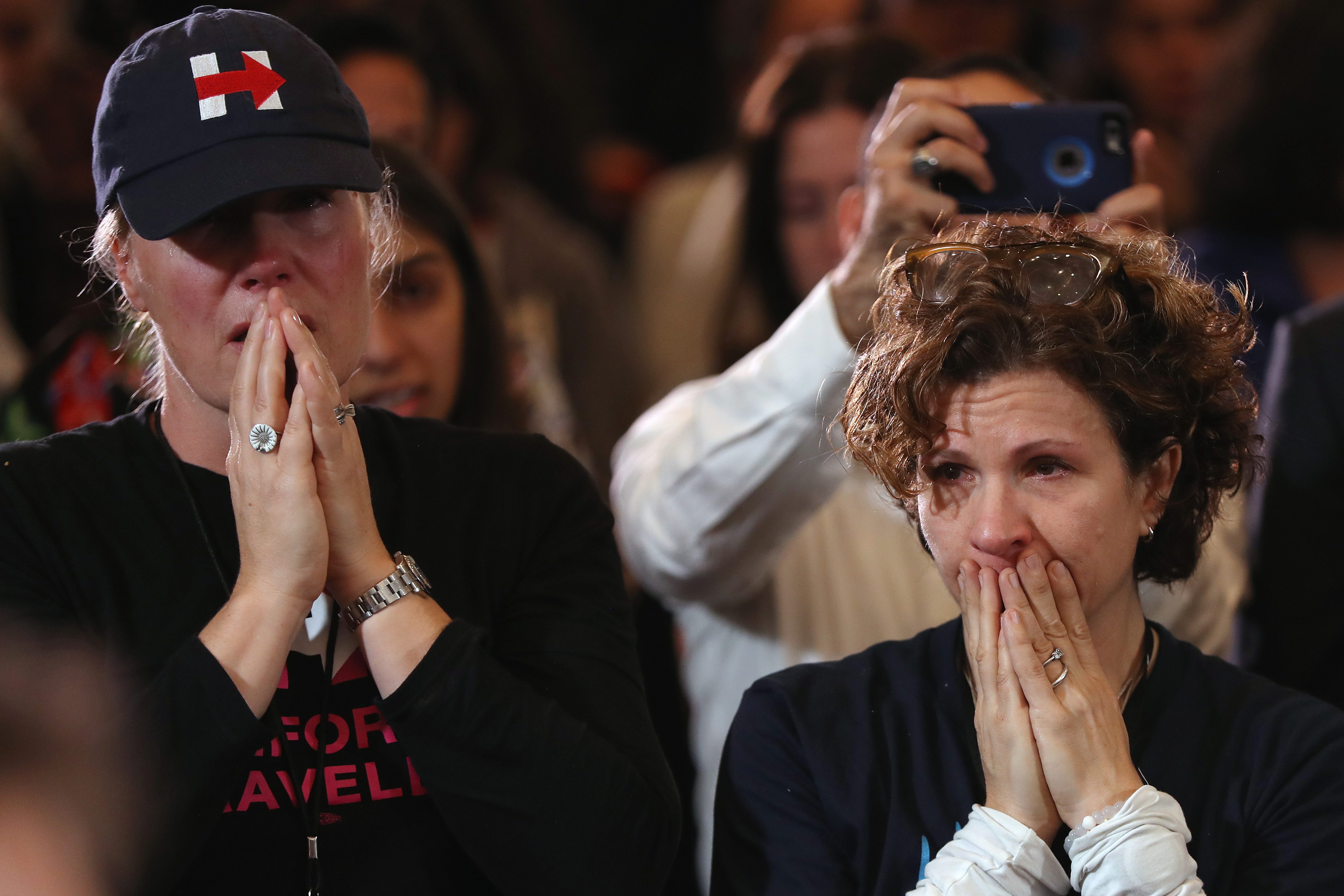 Hillary Clinton supporters weep while listening to her concession speech