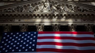 An American flag is displayed at the New York Stock Exchange on Friday, Nov. 11, 2016. (Photo by Michael Nagle/Bloomberg via Getty Images)