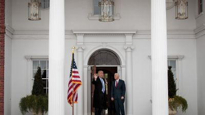 President-elect Donald Trump and Vice President-elect Mike Pence speak briefly to the media as they arrive at the clubhouse at Trump International Golf Club for a day of meetings on Nov. 20, 2016 in Bedminster Township, New Jersey. (Photo by Drew Angerer/Getty Images)