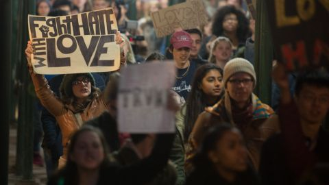 """People march through Manhattan to Trump Tower during a """"Love Rally"""" march in New York on Nov. 11, 2016, to protest the election of President-elect Donald Trump. (Photo by Bryan R. Smith/AFP/Getty Images)"""