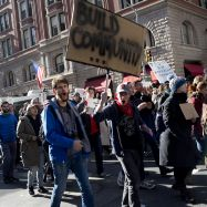 New Yorkers march up Fifth Avenue to protest Donald Trump.