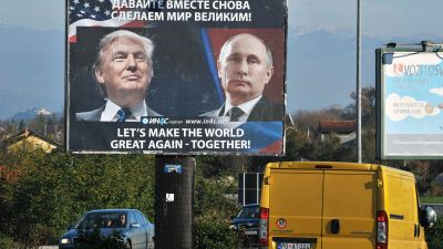 Cars pass by a billboard showing US President-elect Donald Trump and Russian President Vladimir Putin placed by pro-Serbian movement in the town of Danilovgrad on Nov. 16, 2016. Putin and Trump spoke on the phone Nov. 15 and agreed on the need to normalize ties between Washington and Moscow, the Kremlin said. (Photo by Savo Prelevic/AFP/Getty Images)