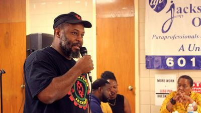 Kali Akuno speaks at Cooperation Jackson's second Annual May Day gathering in 2016. (Photo courtesy of Kali Akuno/Cooperation Jackson)
