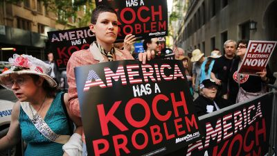 Activists hold a protest near the Manhattan apartment of billionaire and Republican financier David Koch on June 5, 2014 in New York City. The demonstrators were protesting against the campaign contributions by the billionaire Koch brothers who are owners of Koch Industries Inc. (Photo by Spencer Platt/Getty Images)