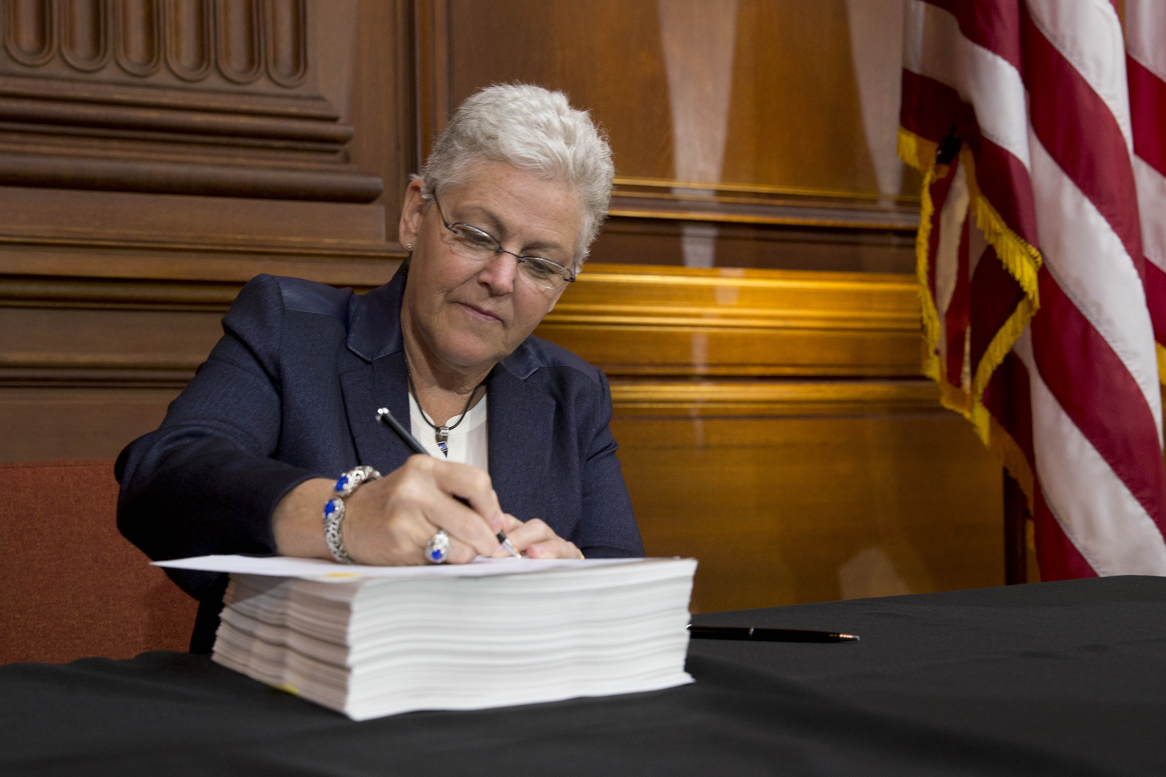 Gina McCarthy, administrator of the Environmental Protection Agency under President Obama, signs a power plant regulation proposal during a news conference in Washington, DC, on June 2, 2014. (Photo by Andrew Harrer/Bloomberg via Getty Images)
