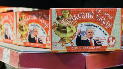 Boxes of sugar cubes bearing the image of US President-elect Donald Trump on sale at a supermarket in Tula, Russia. (Photo by Sergei StarikovTASS via Getty Images)