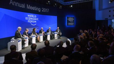 """Participants attend a meeting on the theme """"Monetary Policy: Where Will Things Land?"""" on the opening day of the World Economic Forum, on January 17, 2017 in Davos. The global elite begin a week of earnest debate and Alpine partying in the Swiss ski resort of Davos. (FABRICE COFFRINI/AFP/Getty Images)"""