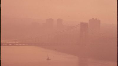 "The George Washington Bridge in heavy smog, photographed during the early 1970s before many of today's clean air protections were put in place. This photograph is part of the Environmental Protection Agency's series to ""Photographically Document Subjects of Environmental Concern,"" compiled 1972-77. (The US National Archives/Flickr)"