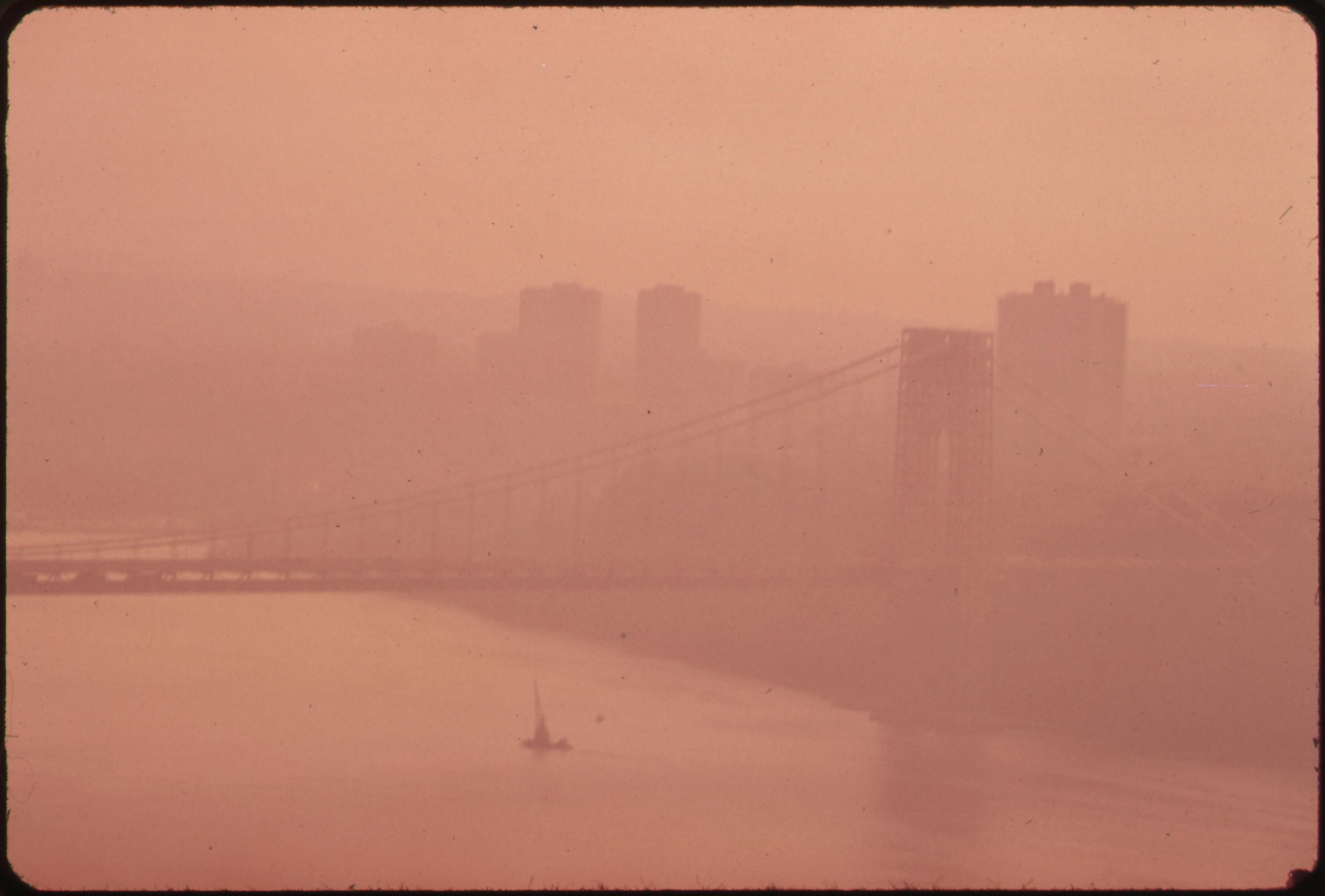 The George Washington Bridge in heavy smog, photographed during the early 1970s before many of today's clean air protections were put in place. This photograph is part of the Environmental Protection Agency's series to