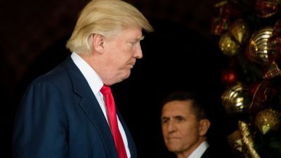 US President-elect Donald Trump (L) stands with Trump National Security Adviser Lt. General Michael Flynn (R) at Mar-a-Lago in Palm Beach, Florida, where he is holding meetings on December 21, 2016. (Jim Watson/AFP/Getty Images)