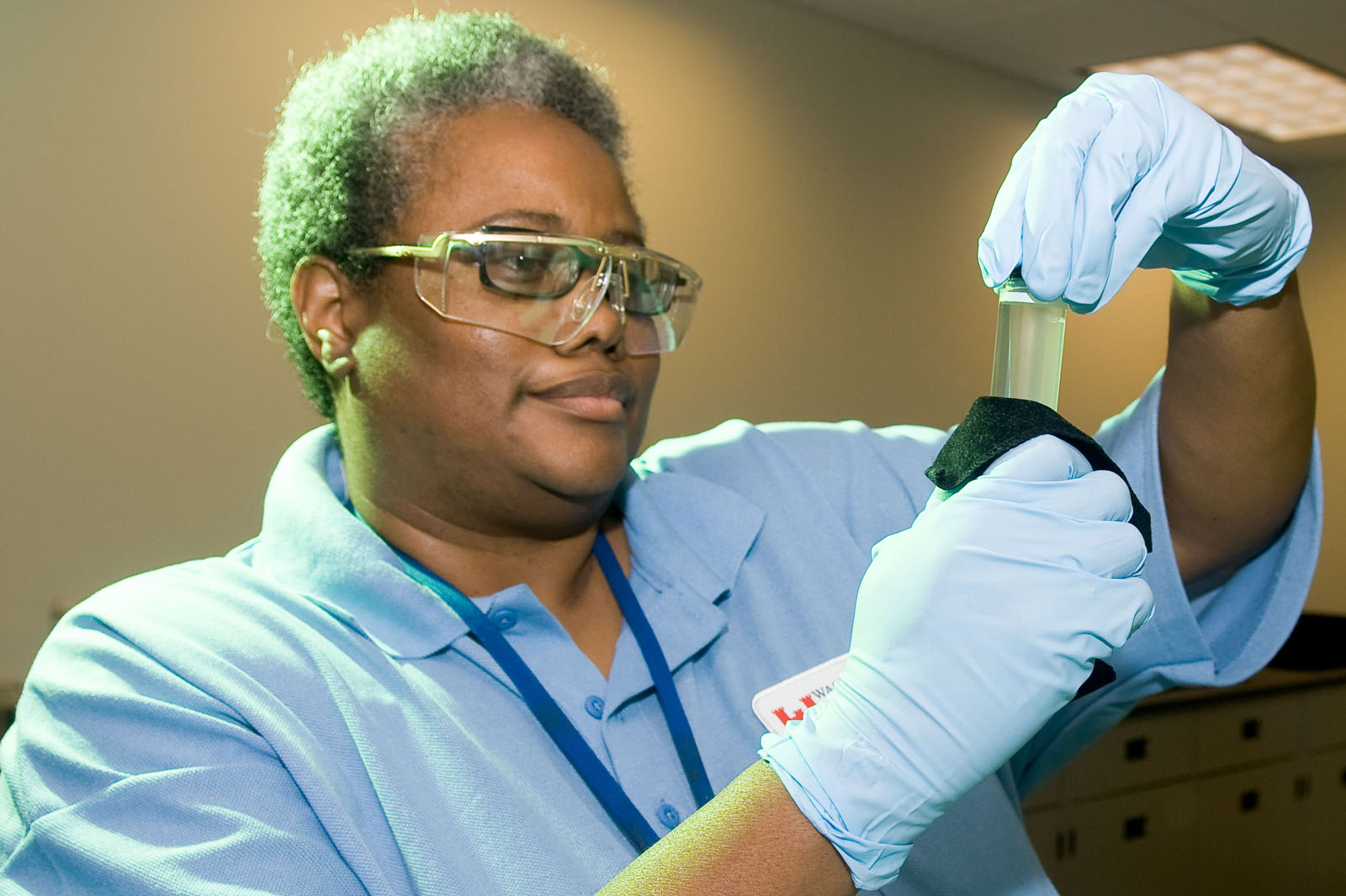 An EPA scientist examines a water sample. (Photo courtesy of EPA)