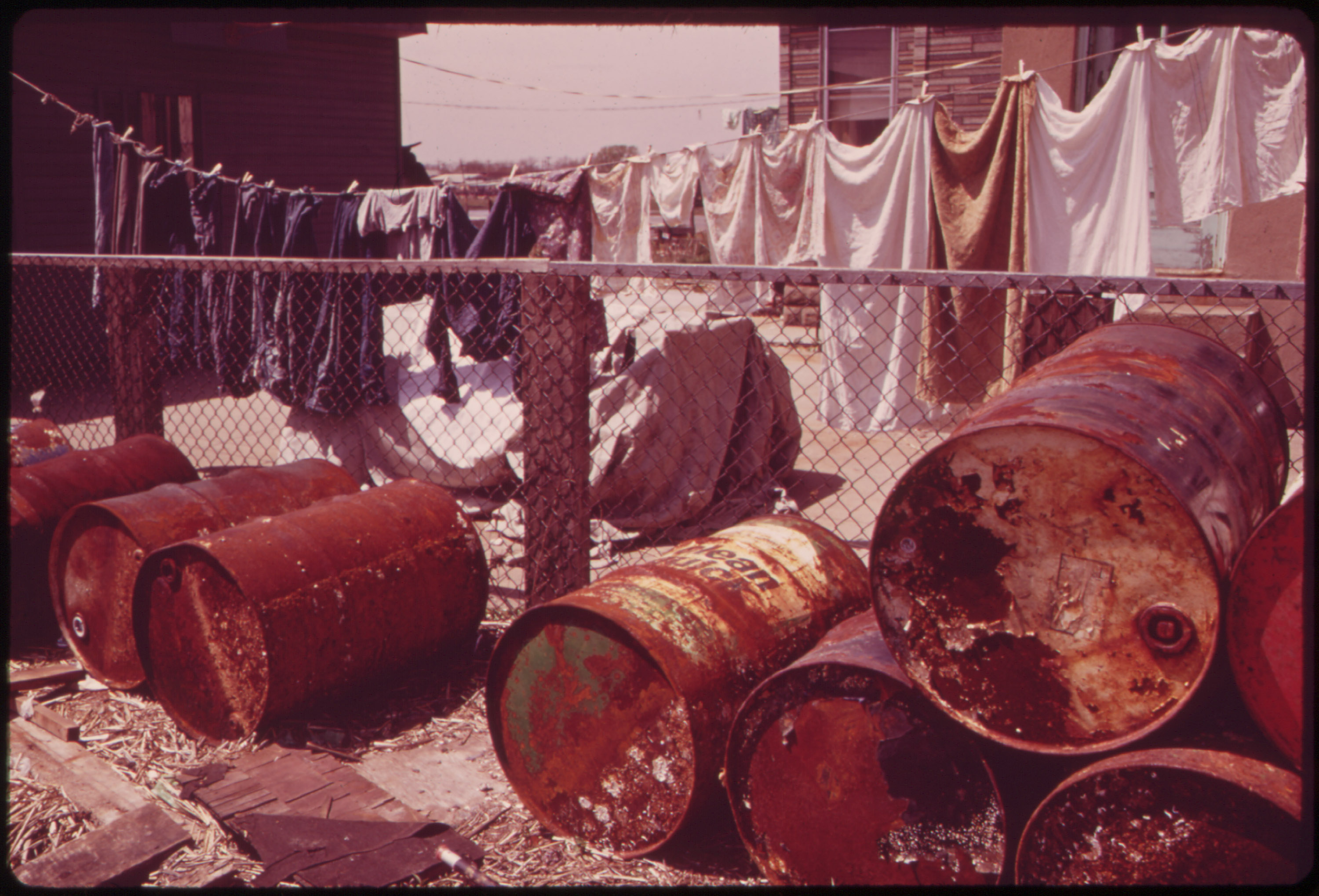 Rusty oil cans near a home in Broad Channel, Queens in May 1973. (Photo courtesy of the National Archives)
