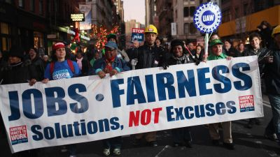 "Members of labor unions and Occupy Wall Street demonstrators participate in a ""March For Jobs and Fairness"" on Dec 1, 2011 in New York City. Thousands attended the late afternoon rally which included members of over 300 New York City and tri-state unions. (Photo by Spencer Platt/Getty Images)"