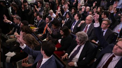 Members of the media raise their hands to ask questions during a daily briefing by White House press secretary Sean Spicer in the James Brady Press Briefing Room on Jan. 23, 2017 in Washington, DC. (Photo by Alex Wong/Getty Images)