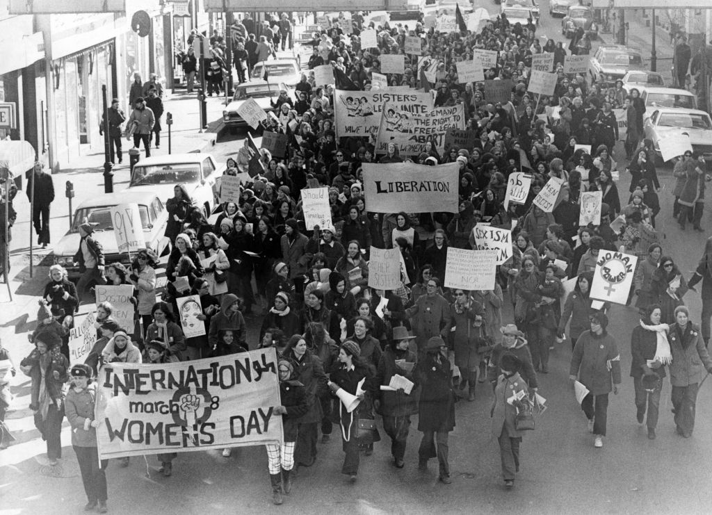 Protesting women led by the Bread and Roses group march along Beacon Street in Boston demanding rights to abortion and equality in work opportunities and conditions, March 8, 1970. (Photo by Don Preston/The Boston Globe via Getty Images)