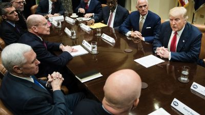President Donald Trump speaks before a meeting with health insurance executives. Clockwise from bottom: Patrick Geraghty, CEO of Florida Blue; Vice President Mike Pence; Stephen Hemsley, CEO of UnitedHealth Group; David Cordani, CEO of Cigna; Scott P. Serota, president and CEO of Blue Cross Blue Shield Association; Andrew Bremberg, director of the Domestic Policy Council; Joseph R. Swedish, CEO of Anthem; Bernard Tyson, CEO of Kaiser Permanente; and Daniel J. Hilferty, president and CEO of Independence Blue Cross, Feb. 27, 2017 in Washington, DC. (Photo by Brendan Smialowski/AFP/Getty Images)