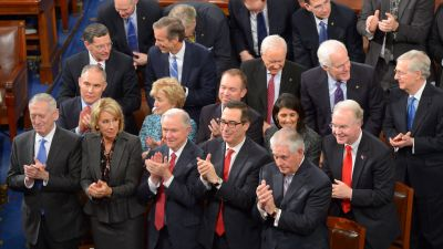 Members of President Donald Trump's Cabinet applaud as he addresses a joint session of Congress on Feb. 28, 2017, in Washington, DC. (Photo by Mandel Ngan/AFP/Getty Images)