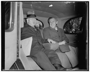 Secretary of Interior Harold Ickes and 'Tommy' Corcoran, the administration's ace 'brain truster,' pictured leaving the White House after a conference with President Roosevelt in Washington, DC, Dec. 6, 1938. (Library of Congress)