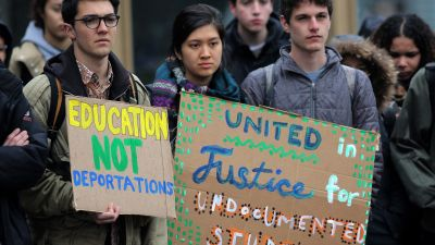 Students participate in a rally at the Tufts University campus on April 7, by the group Tufts United for Immigrant Justice. (Photo by Lane Turner/The Boston Globe via Getty Images)
