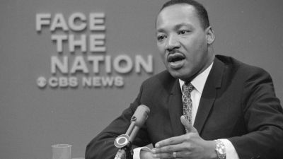 """Rev. Dr. Martin Luther King Jr. appeared on the television news program Face The Nation on April 16, 1967, to discuss his opposition to the war in Vietnam. As """"one greatly concerned about the need for peace in our world and the survival of mankind, I must continue to take a stand on this issue,"""" he said. (Photo by CBS Photo Archive/Getty Images)"""