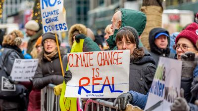 New York activist groups joined a national day of action to urge Sens. Schumer and Gellibrand to stand with science and against climate denial on Jan. 9, 2017. (Photo by Erik McGregor/Pacific Press/LightRocket via Getty Images)
