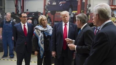 President Donald Trump tours Snap-On Tools alongside Snap-On CEO Nick Pinchuk (second from the right), Treasury Secretary Steve Mnuchin and Education Secretary Betsy DeVos in Kenosha, Wisconsin, April 18, 2017, prior to signing the Buy American, Hire American Executive Order. (Photo credit should read Saul Loeb/AFP/Getty Images)