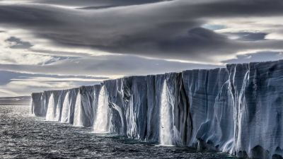 Meltwater gushes from an ice cap on the island of Nordaustlandet, in Norway's Svalbard archipelago. (Photo courtesy of Paul Nicklen)
