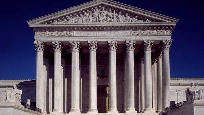"""A view of the Supreme Court Building, with """"Equal Justice Under the Law"""" inscribed on its pediment. (Photo by Carol Highsmith, 1980, Library of Congress)"""