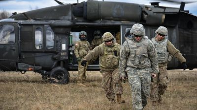 US soldiers, assigned to Public Health Command Europe, collect a simulated causality from a UH-60 Blackhawk, operated by US soldiers assigned to 12th Combat Aviation Brigade, as they conduct different types of Medical Evacuations, at the 7th Army Training Command's Grafenwoehr Training Area, Germany, March 21, 2017. (US Army photo by Sgt. Sara Stalvey, US Department of Defense/ flickr Public Domain)