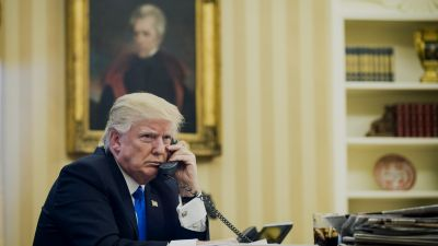 President Donald Trump speaks on the phone with Malcolm Turnbull, Australia's prime minister, during the first official phone talks in the Oval Office of the White House on Saturday, Jan. 28, 2017. (Photo by Pete Marovich/Pool via Bloomberg)