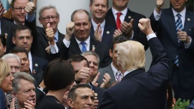 President Donald Trump congratulates House Republicans after they passed legislation aimed at repealing and replacing ObamaCare, during an event in the Rose Garden at the White House, on May 4, 2017 in Washington, DC. The House bill would still need to be passed by the Senate before it could be signed into law. (Photo by Mark Wilson/Getty Images)