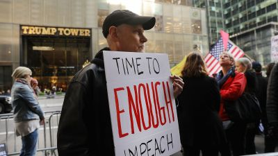 Protesters gather outside of Trump Tower a day after FBI Director James Comey was fired by President Donald Trump on May 10, 2017 in New York City. (Photo by Spencer Platt/Getty Images)