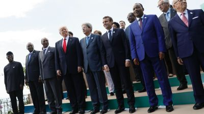 Trump poses with world leaders at the G-7 Summit on May 27, 2017 in Taormina, Sicily. (Left to right) Nigerian Vice President Yemi Osinbajo, Kenya's President Uhuru Kenyatta, Guinea's President Alpha Conde, US President Donald Trump, Italian Prime Minister Paolo Gentiloni, French President Emmanuel Macron, Niger's President Mahamadou Issoufou and Tunisian President Beji Caid Essebsi. (Photo by Jonathan Ernst/AFP/Getty Images)