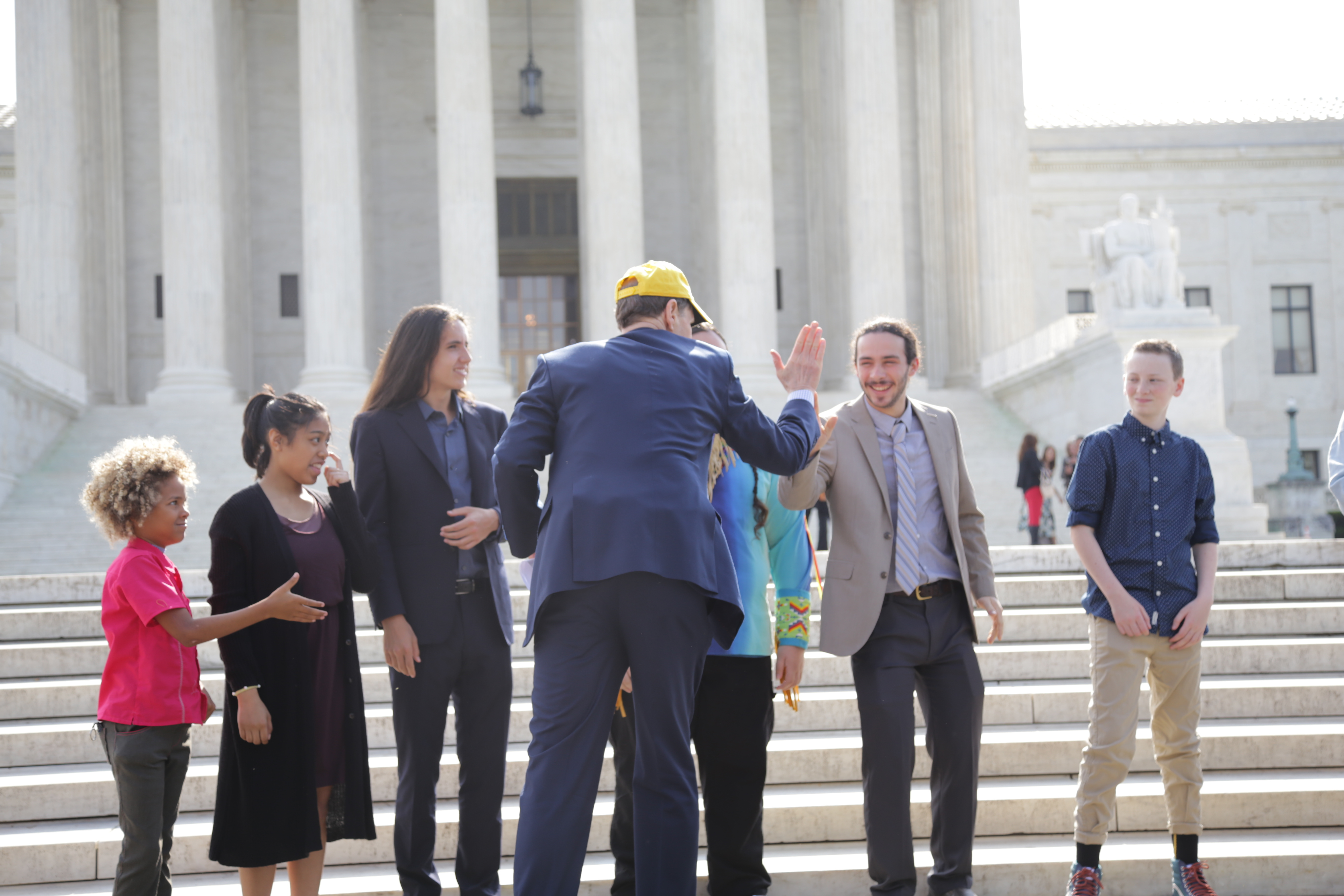 Sen. Ron Wyden (D-OR) high-fives Jacob Lebel, 20, one of the plaintiffs in the Our Childrens Trust suit. (Photo by John Light)