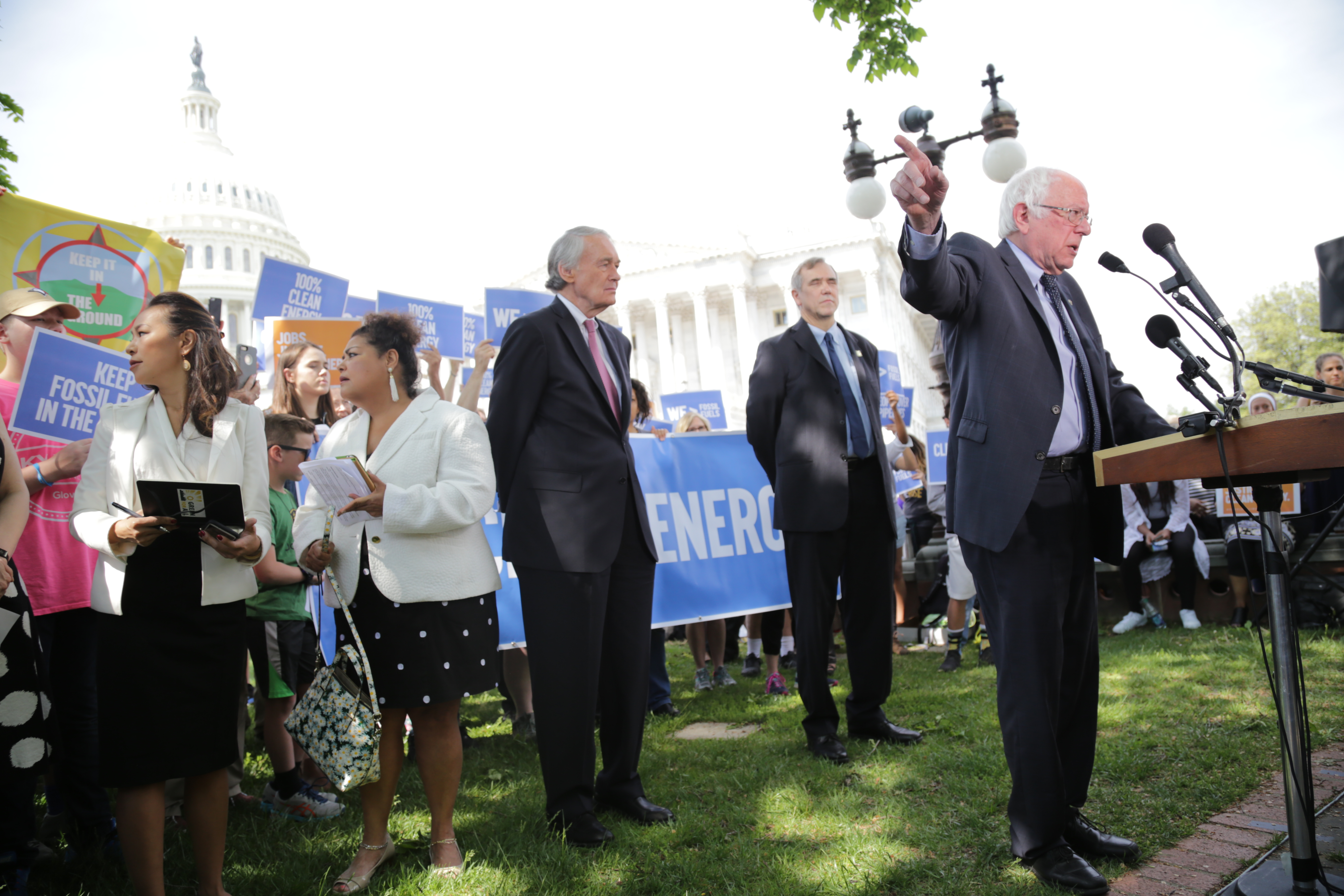 Sen. Bernie Sanders (I-VT) speaks as Sens. Ed Markey (D-MA) and Jeff Merkley (D-OR) listen during a press conference to introduce a bill to transition to a 100 percent renewable economy by 2050. (Photo by John Light)