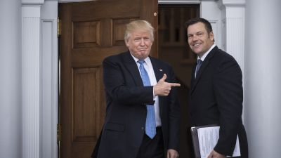 President-elect Donald Trump greets Kansas Secretary of State Kris Kobach at Trump National Golf Club Bedminster in Bedminster Township, New Jersey on Nov. 20, 2016. (Photo by Jabin Botsford/The Washington Post via Getty Images)