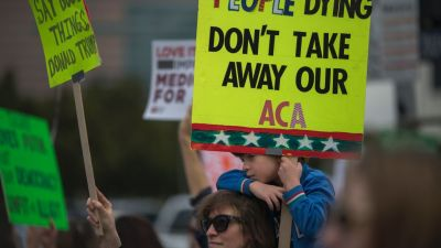 People protest Trump administration policies that threaten the Affordable Care Act, Medicare and Medicaid near the Wilshire Federal Building on Jan. 25, 2017 in Los Angeles. (Photo by David McNew/AFP/Getty Images)