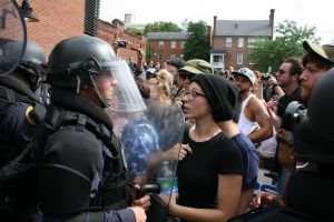 Protester and police officer at anti-Klan rally in Charlottesville, Virginia.