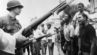 Black demonstrators face armed federal soldiers in Newark on July 17, 1967 during riots that erupted in the town following a police operation. (Photo by AFP/Getty Images)