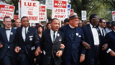 Leaders of March on Washington for Jobs & Freedom marching with signs. Left to right: Matthew Ahmann, Floyd McKissick Jr., Martin Luther King Jr., Eugene Carson Blake and Cleveland Robinson. (Photo by Robert W. Kelley/The LIFE Picture Collection/Getty Images)