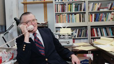 Professor James McGill Buchanan, of George Mason University, talks on the telephone soon after it was announced that he was awarded the 1986 Nobel Prize in Economics. (Getty Images)