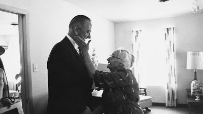 An elderly woman shows her gratitude to President Lyndon B. Johnson for his signing of the Medicare health care bill in July 1965. (Photo by © CORBIS/Corbis via Getty Images)