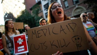 A small group of activists rally against the GOP health care plan outside of the Metropolitan Republican Club, in New York City on July 5, 2017.. Republicans in the Senate will resume work on the bill next week when Congress returns to Washington after a holiday recess. (Photo by Drew Angerer/Getty Images)