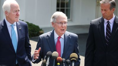 Senate Majority Leader Mitch McConnell (R-KY)(center), Sen. John Thune (R-SD)(right) and Sen. John Cornyn (R-TX) speak to the media at the White House on July 19, 2017. The senators met with President Donald Trump to discuss the health care bill. (Photo by Mark Wilson/Getty Images)
