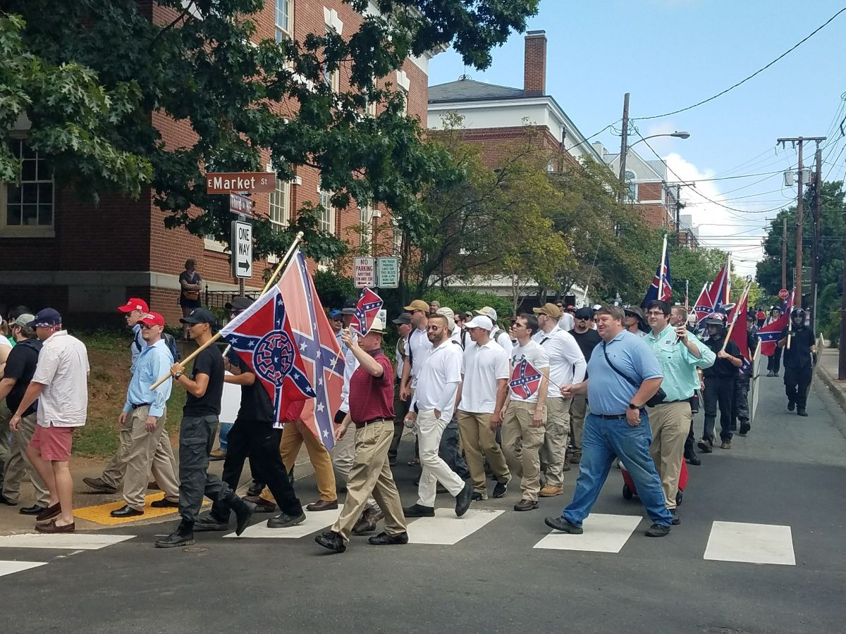Unite the Right rally attendees descend on Charlottesville, some wearing their Trump baseball hats and Trump's customary golf outfit: white polo shirt and khakis. (Photo by Adele Stan)