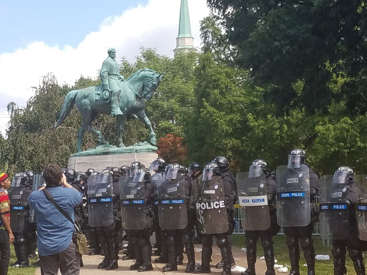 Police guarded the entrance to Emancipation Park in front of the controversial statue of Robert E. Lee, which the city council voted to remove earlier this year. (Photo by Adele Stan)