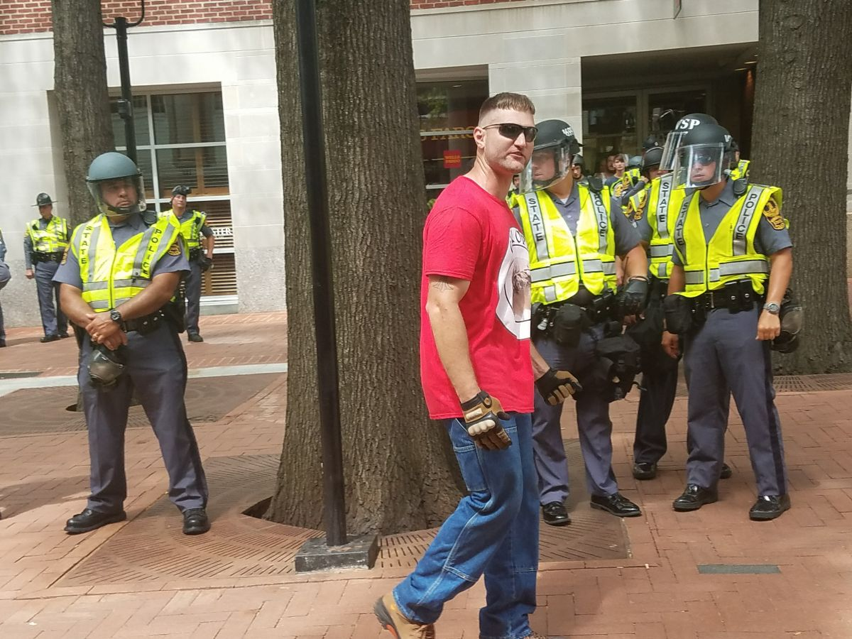 A protester at wearing a Evropa T-shirt yelling epithets. (Photo by Adele Stan)